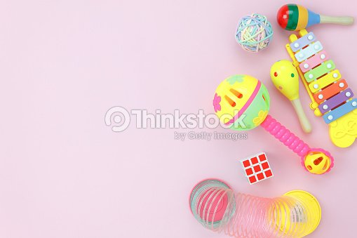 Table top view image the kids toys for development background concept.Flat lay accessory objects for children on modern rustic pink at home office desk.Design pastel tone with copy space for add text. : Stock Photo