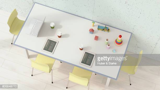 table with computer and toys