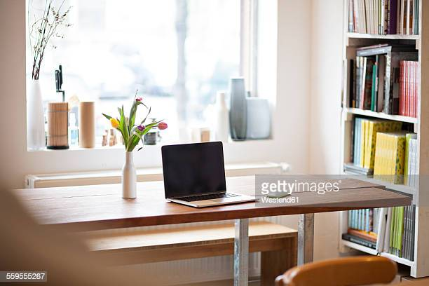 Table with laptop in a modern individual bistro
