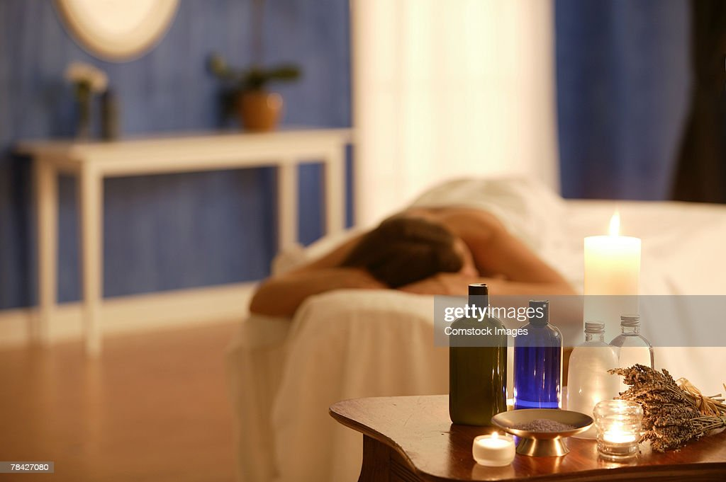 Table with massage oils : Stock Photo