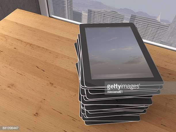 Table with stack of digital tablets, 3D Rendering