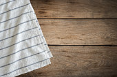 White tablecloth on wood background with copy space.