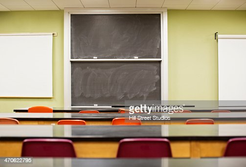 Tables and blackboard in empty lecture hall