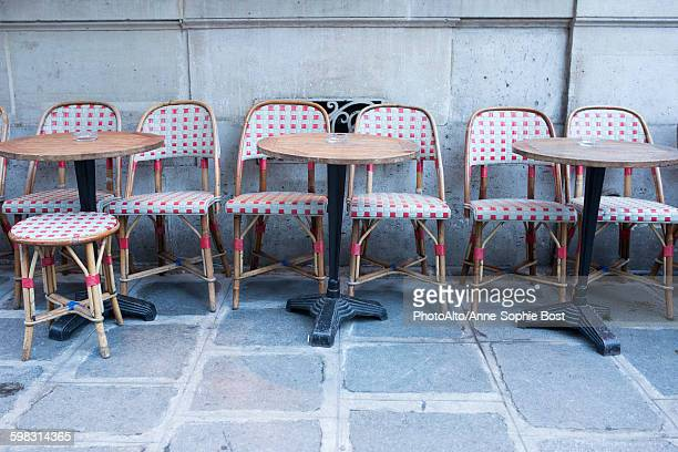 Tables and chairs at empty sidewalk cafe