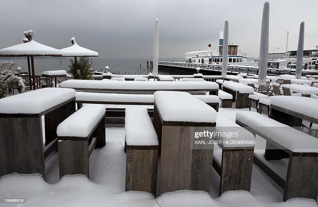 Tables and chairs of a beer garden are covered with a thick layer of snow near Stegen, southern Germany, on January 18, 2013.