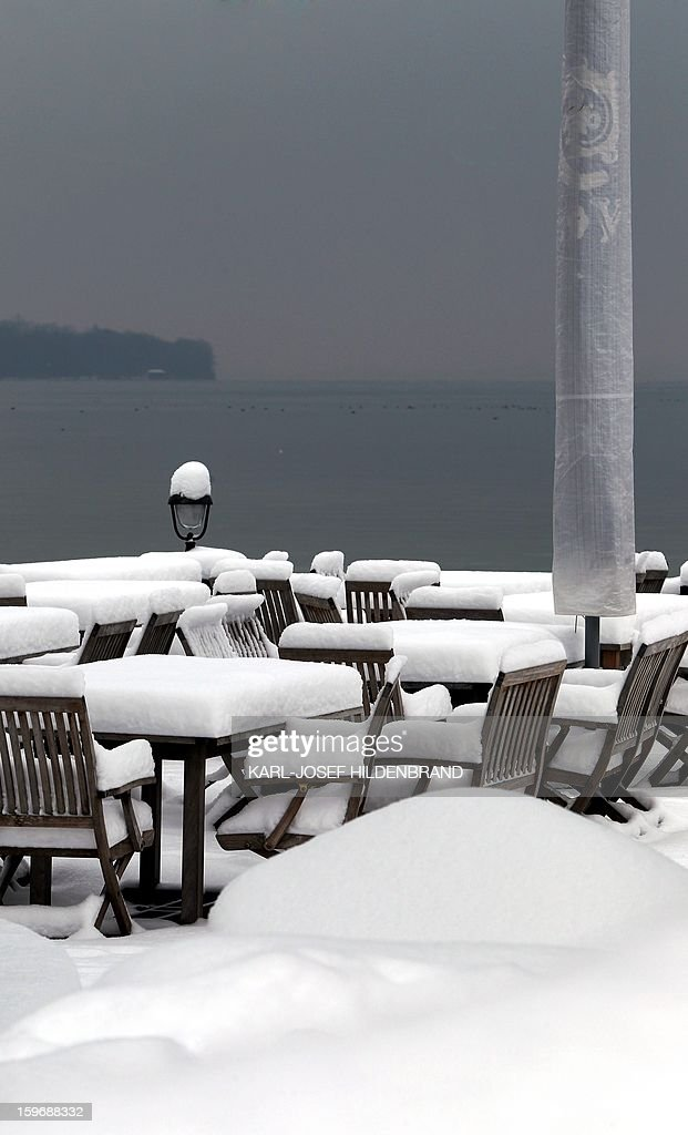 Tables and chairs of a beer garden are covered with a thick layer of snow near Stegen, southern Germany, on January 18, 2013. AFP PHOTO / KARL-JOSEF HILDENBRAND /GERMANY OUT