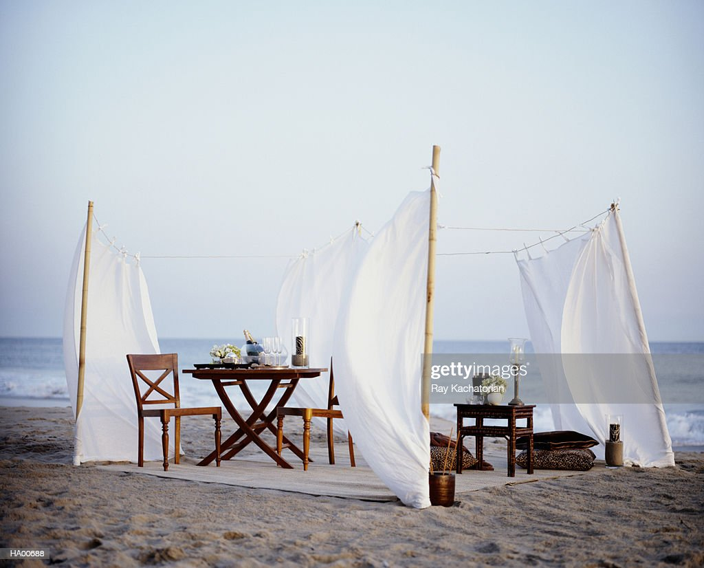 Tables and chairs on beach,  champagne in bowl with ice : Stock Photo