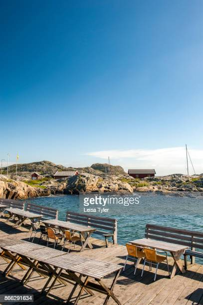 Tables and chairs outside Väderöarna Värdshus a guesthouse on the Weather Islands a clutch of barefaced rocks in the Bohuslän Archipelago West Sweden...