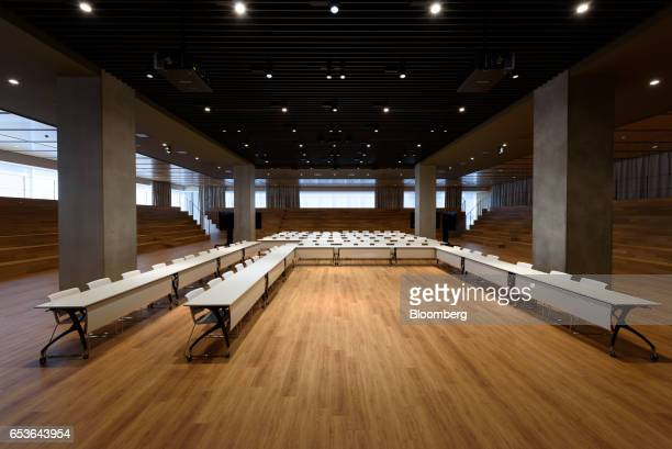 Tables and chairs stand in the great hall at Fast Retailing Co's Uniqlo City Tokyo office in Tokyo Japan on Friday March 10 2017 Uniqlo owner Fast...