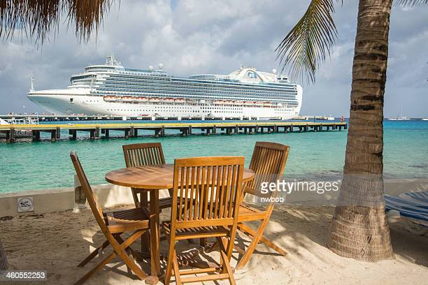 Tables and Palm Trees await Cruise Passengers