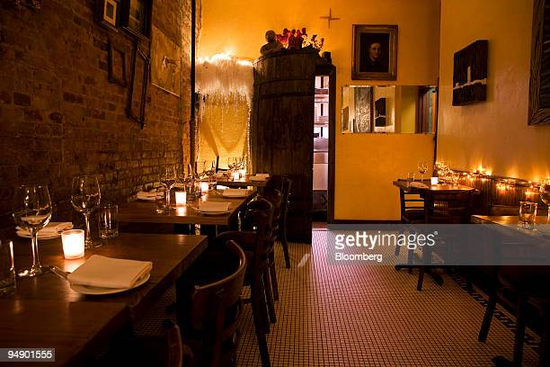 Tables are set for diners at Tree in the East Village neighborhood of New York US on Thursday Jan 31 2008 Tree is a charming splinter of a room an...