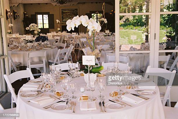 Tables decorated at stylish wedding reception