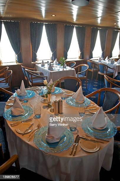 Tables set for dinner in restaurant aboard Wind Spirit of Windstar Cruises