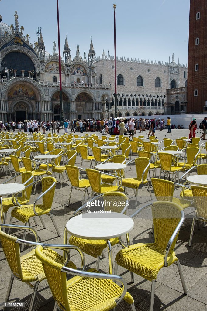 Tables sit empty in the heat at a cafe in St Mark's Square on June 21, 2012 in Venice, Italy. An intense heatwave is sweeping across many regions in Italy, prompting the country's health ministry to issue a number of high level alerts.