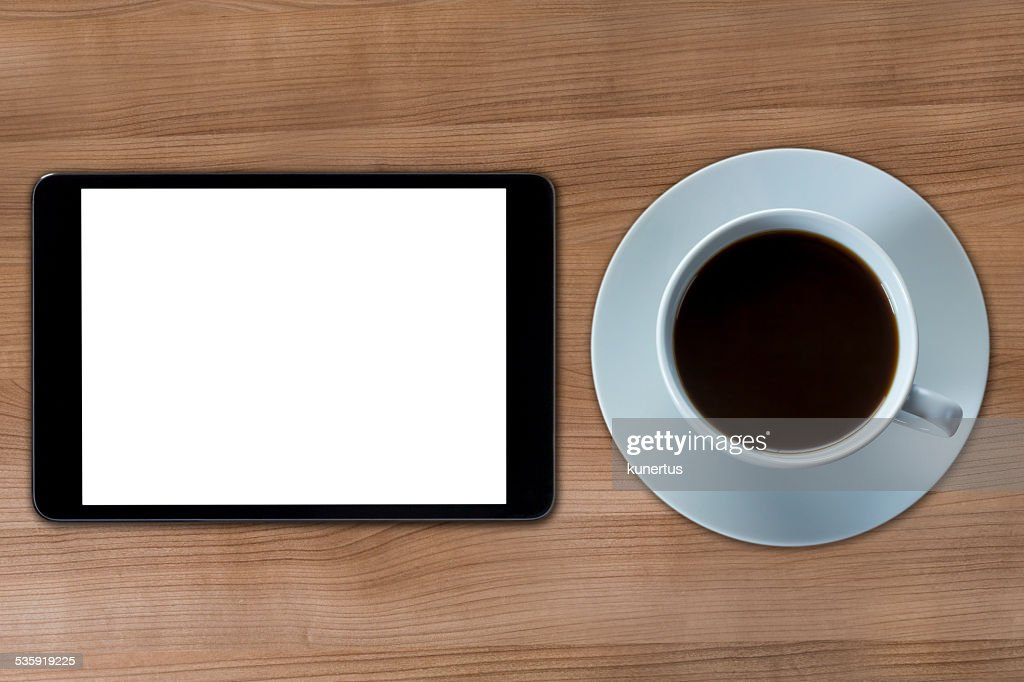 Tablet computer and cup of coffee : Stock Photo