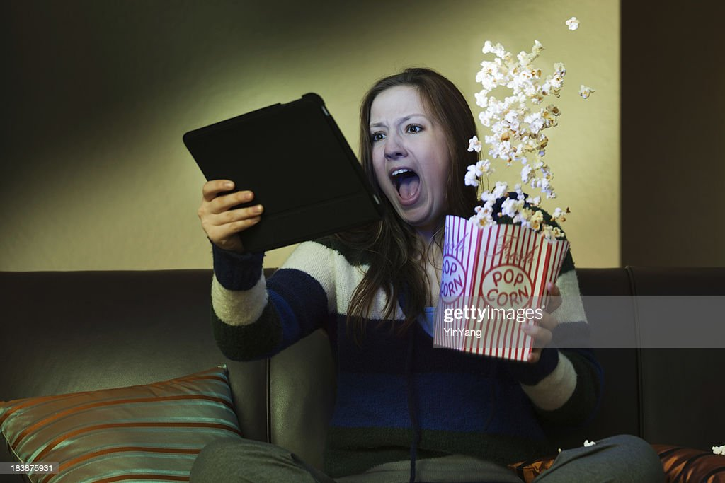 'Tablet Computer Entertainment, Watching Scary Movie Screaming wi'