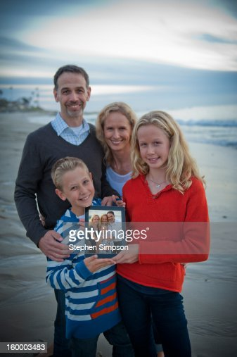 tablet computer family portrait on the beach : Stock Photo