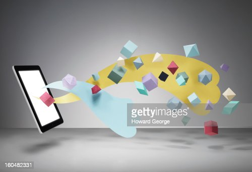Ipad with geometric shapes floating