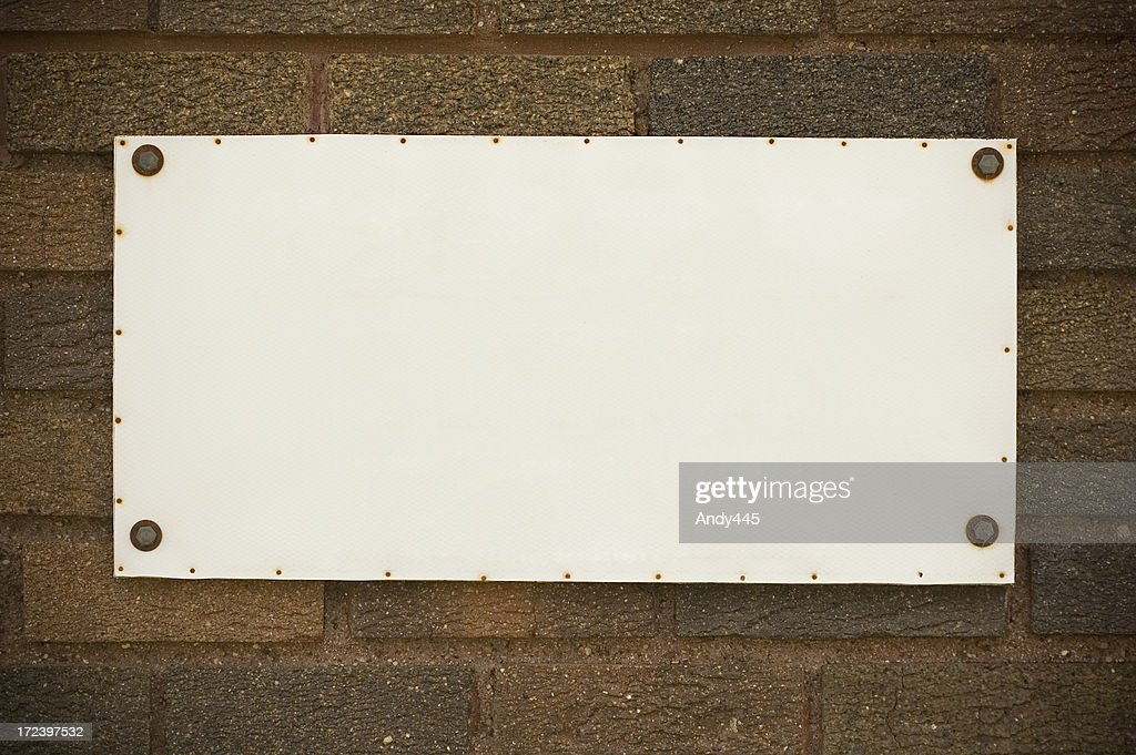 Tablet on the brick wall