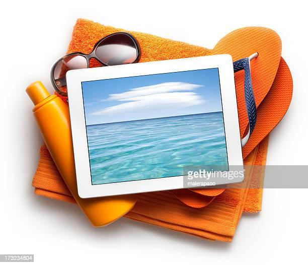 Tablette avec des accessoires de plage