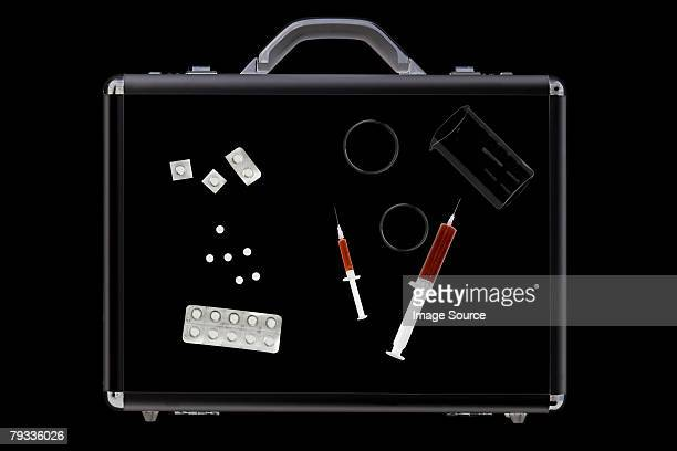 Tablets and syringes in briefcase