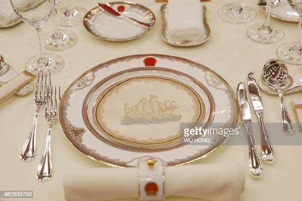 Tablewares are pictured before the welcoming banquet of the Belt and Road Forum in Beijing's Great Hall of the People on May 14 2017 China touted its...