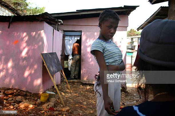 Tablita a 14yearold 'restavek' speaks with her 'host' on March 30 2005 in PortauPrince Haiti Tablita worries about her emminent departure from the...