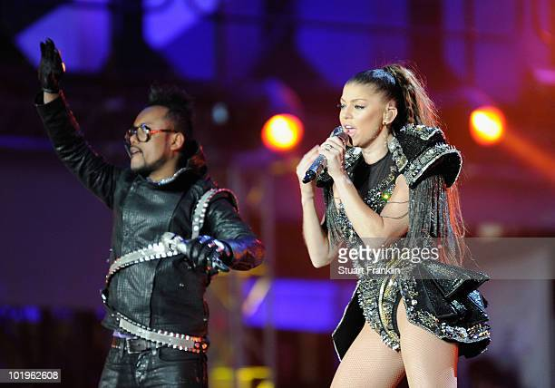 Taboo and Fergie of the Black eyed peas performs a song during the kickoff celebration concert for the 2010 FIFA World Cup at the Orlando Stadium on...