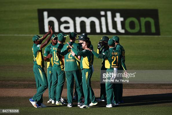 Tabraiz Shamsi of South Africa celebrates with teammates for the wicket of Kane Williamson of New Zealand during the First One Day International...