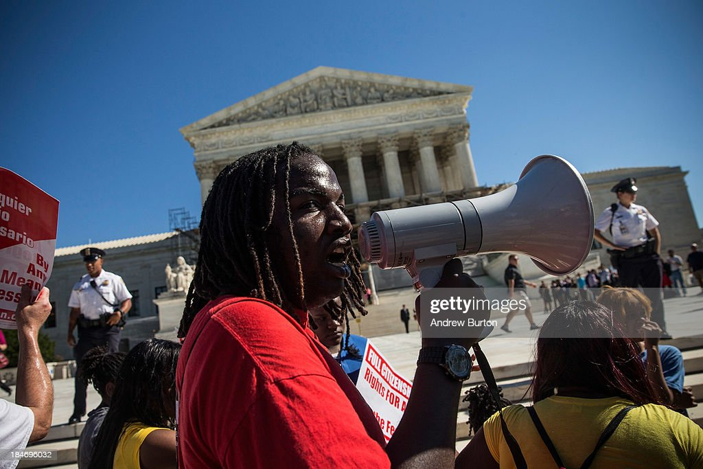 Tabrian Joe, a Sophomore at Western MIchigan University, leads a protest in support of affirmative action, outside the Supreme Court during the hearing of 'Schuette v. Coalition to Defend Affirmative Action' on October 15, 2013 in Washington, DC. The case revolves around affirmative action and whether or not states have the right to ban schools from using race as a consideration in school admissions.