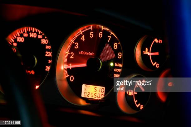 A tachometer lit up in a vehicle that is turned on