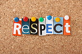 The word Respect in cut out magazine letters pinned to a cork notice board