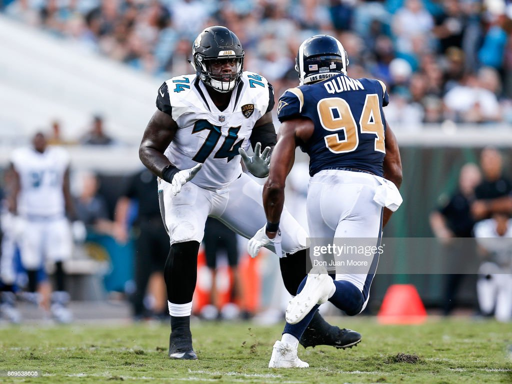 Tackle Cam Robinson #74 of the Jacksonville Jaguars blocks Defensive End Robert Quinn #94 of the Los Angeles Rams during the game at EverBank Field on October 15, 2017 in Jacksonville, Florida. The Rams defeated the Jaguars 27 to 17.