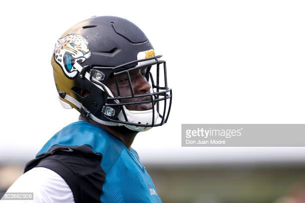 Tackle Cam Robinson of the Jacksonville Jaguars works out during Training Camp at Florida Blue Health and Wellness Practice Fields on July 27 2017 in...