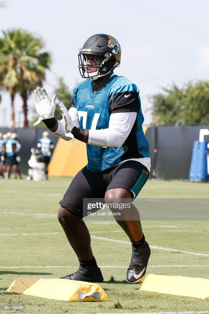 Tackle Cam Robinson #74 of the Jacksonville Jaguars works out during Training Camp at Florida Blue Health and Wellness Practice Fields on July 28, 2017 in Jacksonville, Florida.