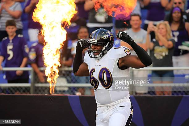 Tackle Eugene Monroe of the Baltimore Ravens is introduced before the start of an NFL preseason game against the San Francisco 49ers at MT Bank...
