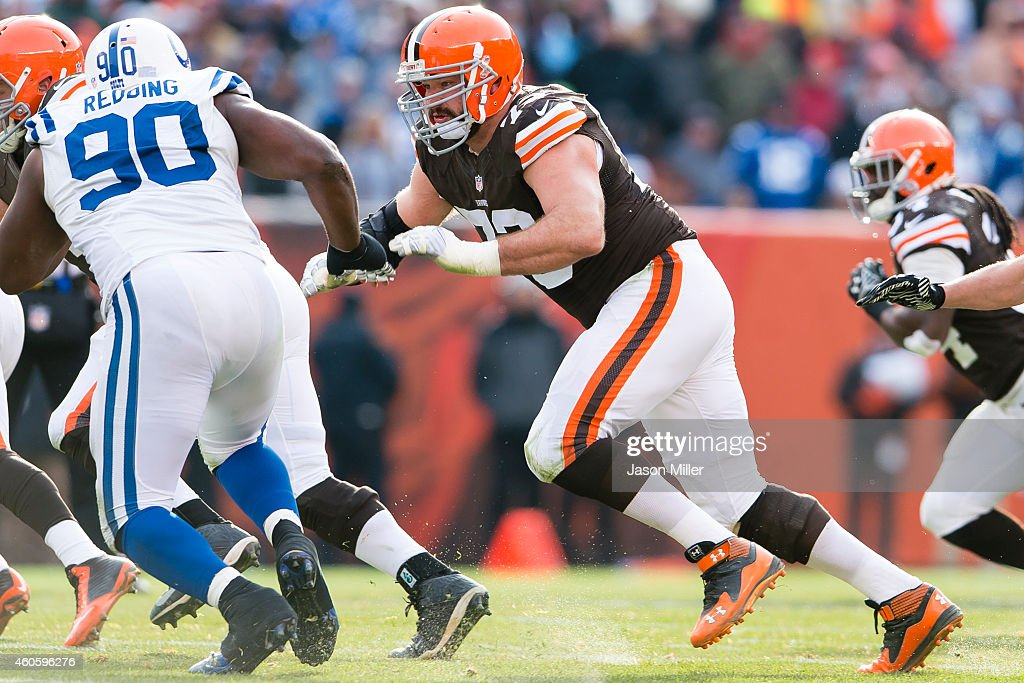 Tackle Joe Thomas of the Cleveland Browns blocks defensive end Cory Redding of the Indianapolis Colts during the first half at FirstEnergy Stadium on...