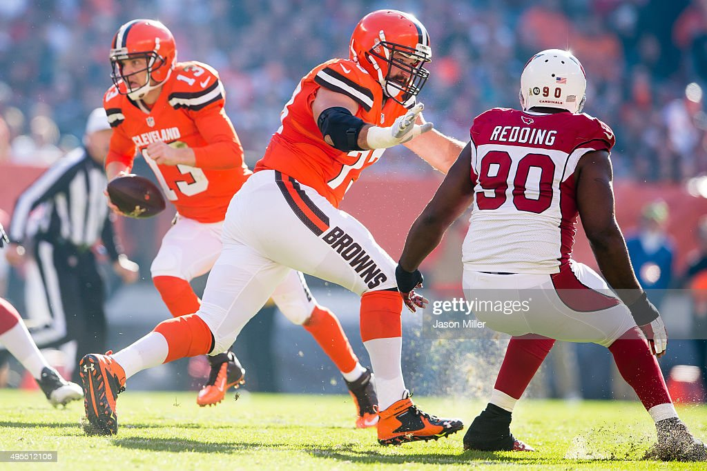 Tackle Joe Thomas of the Cleveland Browns blocks defensive end Cory Redding of the Arizona Cardinals during the first half at FirstEnergy Stadium on...