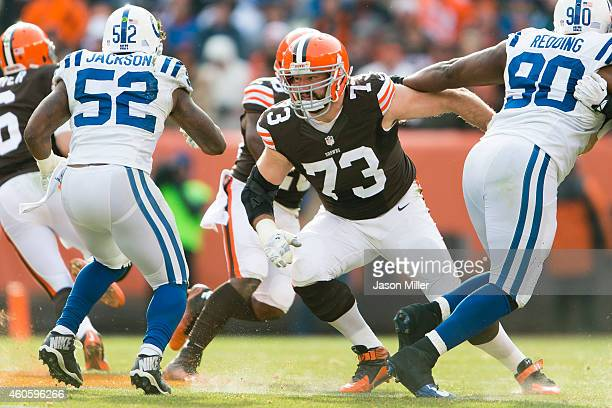 Tackle Joe Thomas of the Cleveland Browns blocks inside linebacker D'Qwell Jackson during the first half at FirstEnergy Stadium on December 7 2014 in...