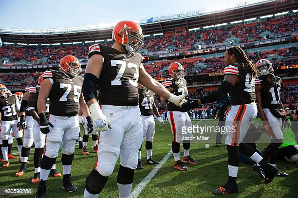 Tackle Joe Thomas of the Cleveland Browns celebrates with teammates during player introductions prior to the game against the Indianapolis Colts at...