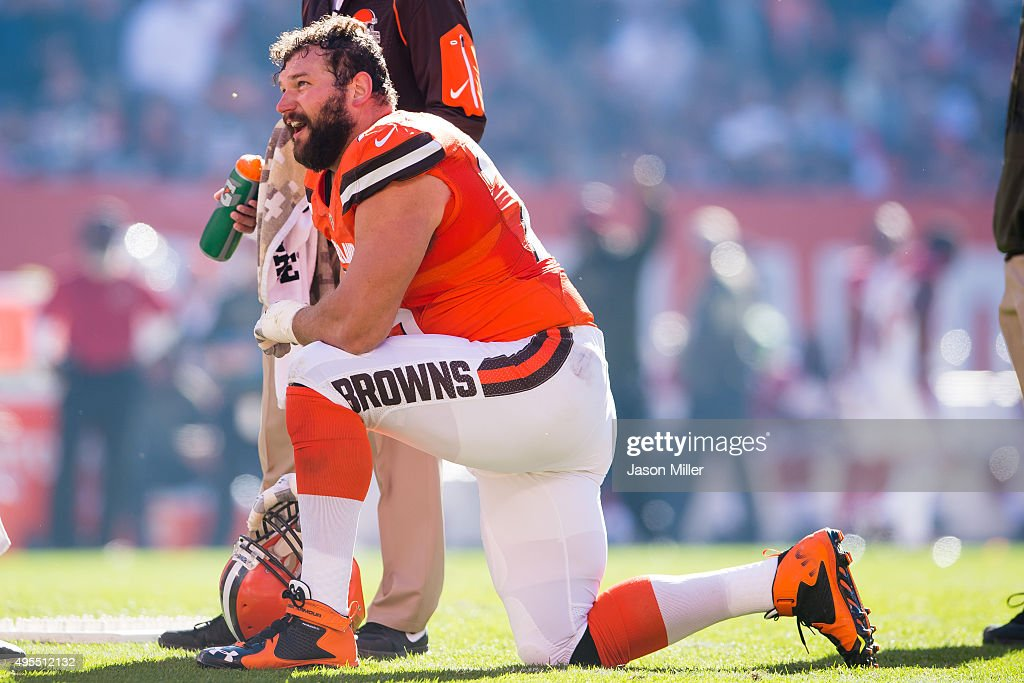 Tackle Joe Thomas of the Cleveland Browns takes a knee during a timeout against the Arizona Cardinals during the first half at FirstEnergy Stadium on...