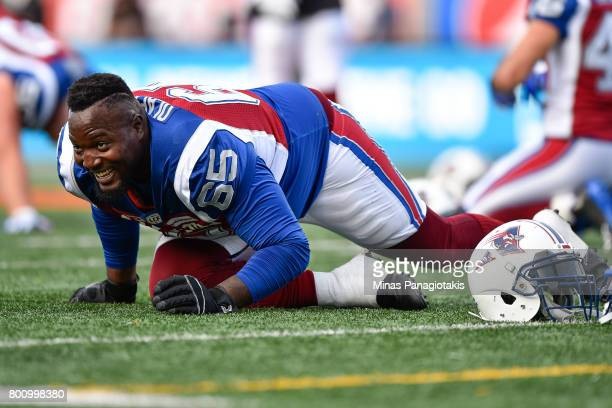 Tackle Jovan Olafioye of the Montreal Alouettes stretches during the warmup prior to the CFL game against the Saskatchewan Roughriders at Percival...