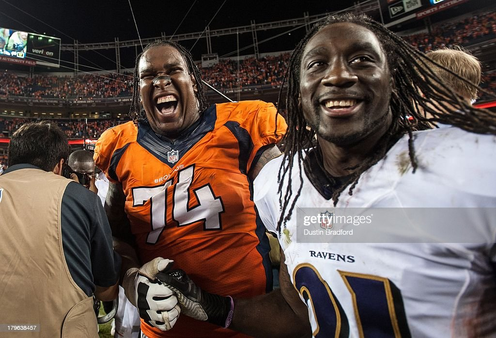 Tackle <a gi-track='captionPersonalityLinkClicked' href=/galleries/search?phrase=Orlando+Franklin&family=editorial&specificpeople=5512610 ng-click='$event.stopPropagation()'>Orlando Franklin</a> #74 of the Denver Broncos and cornerback of <a gi-track='captionPersonalityLinkClicked' href=/galleries/search?phrase=Lardarius+Webb&family=editorial&specificpeople=5735454 ng-click='$event.stopPropagation()'>Lardarius Webb</a> #21 of shake hands and laugh after the game at Sports Authority Field at Mile High on September 5, 2013 in Denver Colorado.
