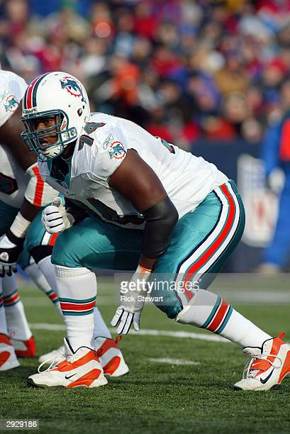 Tackle Wade Smith of the Miami Dolphins awaits the snap during the game against the Buffalo Bills on December 21 2003 at Ralph Wilson Stadium in...