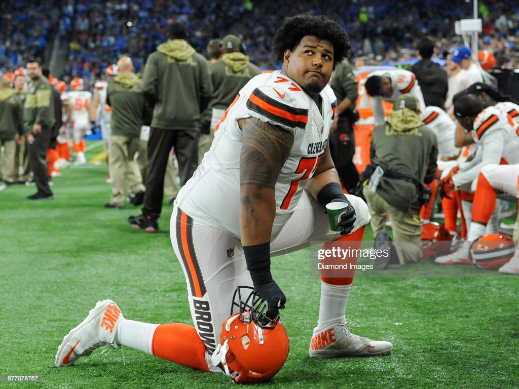 Tackle Zach Banner #77 of the Cleveland Browns kneels on the sideline as he watches the action from the sideline in the second quarter of a game on November 12, 2017 against the Detroit Lions at Ford Field in Detroit, Michigan. Detroit won 38-24.