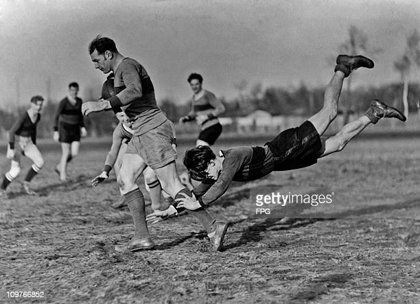 Tackling during a rugby training session in Berlin Germany circa 1930
