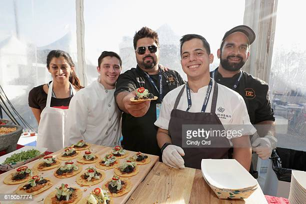 Taco Bamba Taqueria team members attend the CocaCola Backyard BBQ hosted by Bobby Flay and Michael Symon presented by Thrillist sponsored by National...