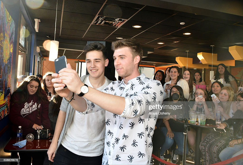 Taco Bell spokesperson (R) takes a moment to pose with Jacob Whitesides (L) after the Feed The Beat® performance on February 6, 2016.