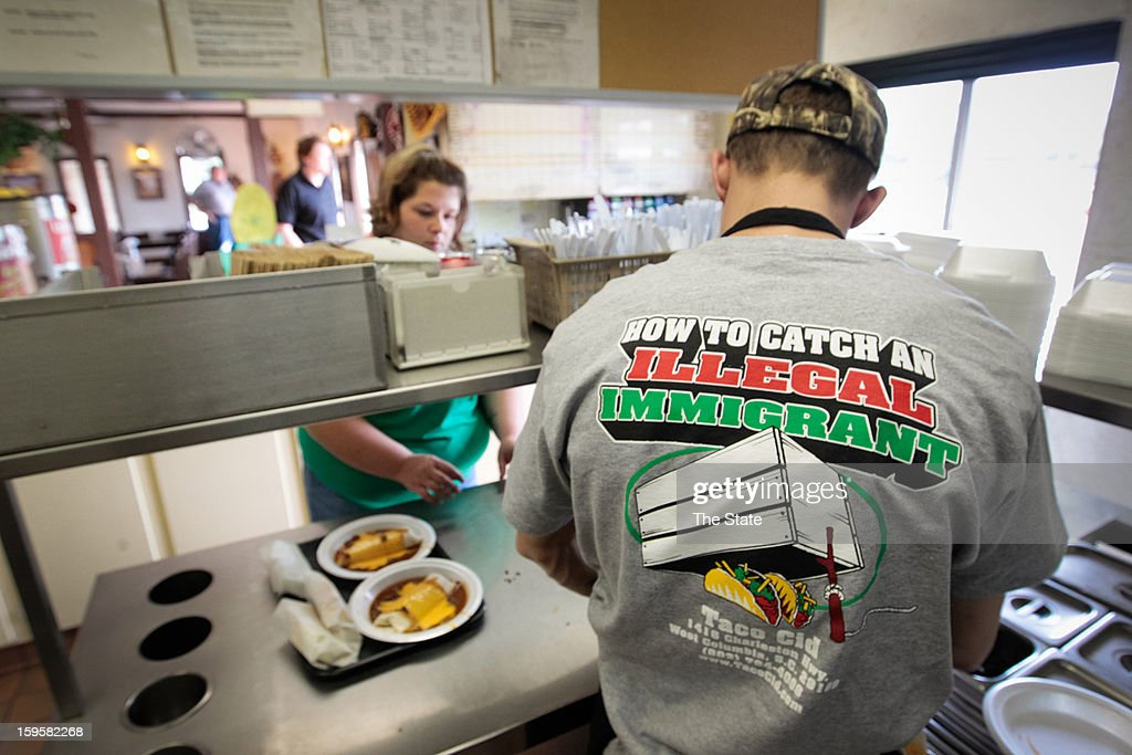Taco Cid owners Leanne Snelgrove and husband, Jason, wear T-shirts comparing catching illegal immigrants to capturing animals. The West Columbia, South Carolina restaurant has seen a spike in business since the controversy made national headlines.