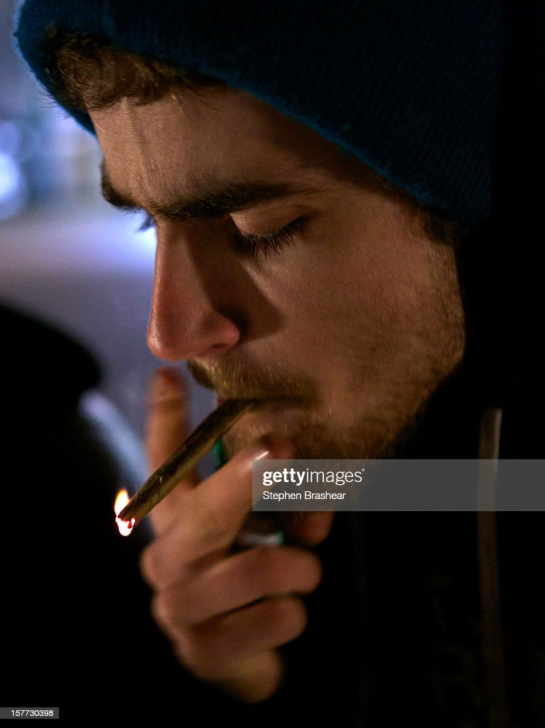 A Tacoma resident smokes marijuana shortly after a law legalizing the recreational use of marijuana took effect on December 6, 2012 in Seattle, Washington. Voters approved an initiative to decriminalize the recreational use of marijuana making it one of the first states to do so.